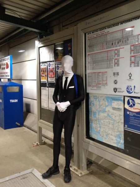 masked man train station