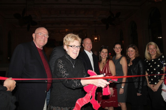 Joan Solomine (with joe Solomine, Sr. cut the ribbon for the new One Wolfs Lane in Pelham