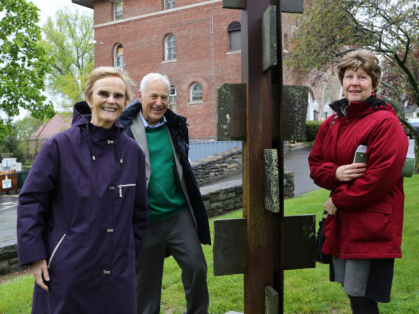 Michael Rosenbaum, center, seen at recent unveiling of sculpture he donated to Mamatroneck Village